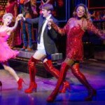 """Pic.KINKY BOOTS I love musicals. In fact I love them so much that I listen to """"Wicked""""s sound track every morning on the way to school. When my grandma offered to take us up to London to watch Kinky Boots, I could not refuse. My friend went to see it on Broadway and told me it was amazing and that the songs were so catchy. At first I was a bit sceptical because of the name but when it started I knew that I was going to enjoy it so much. The story is about Charlie Price, who turns an Northampton shoe factory which is on the brink of closing, into a success by making boots for drag queens who want thigh-high red boots. Hence the name, Kinky Boots. At the same time, we see how Lola, the project's design consultant who is also a drag queen, makes Charlie and his co-workers overcome their dislike of men in frocks. All ends happily at a Milan shoe fair where the collapsing business is joyously 'rebooted'. The songs were super duper good and the story line was very interesting and personally, I had my eyes glued to the stage the whole time. I would say that this particular musical is great for lots of people, but I personally would recommend it for ages 10+, just because of some of the language and scenes. The show was really funny and had me and my sister laughing, but some of it was quite emotional. Don't worry I won't spoil it. All in all I would really recommend this musical and I have been listening to the songs nonstop after seeing it. See it at the Adelphi Theatre, The Strand, London."""